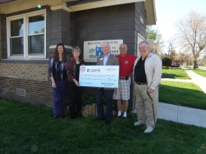 Photo caption: Mark Kappler, center, presents the grant check to Housing Services, represented by, from left, assistant director Christie Harry, director Denise Dunn, treasurer Jim Dexter, and trustee Dar Benjamin.
